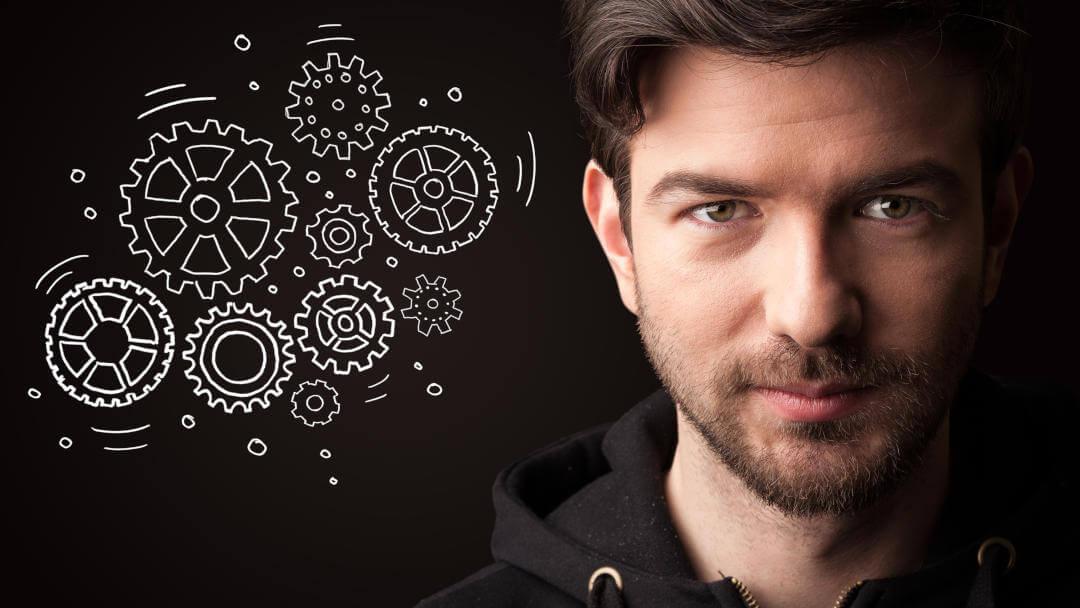 Werbewirkung kann bei jedem Menschen anders ausfallen. Das Bild zeigt den Kopf einesjungen Mannes und daneben Zahnräder. Diese stehen für Prozesse, welche z.B. durch die Wahrnehmung von Werbemitteln im Gehirn angestoßen werden.
